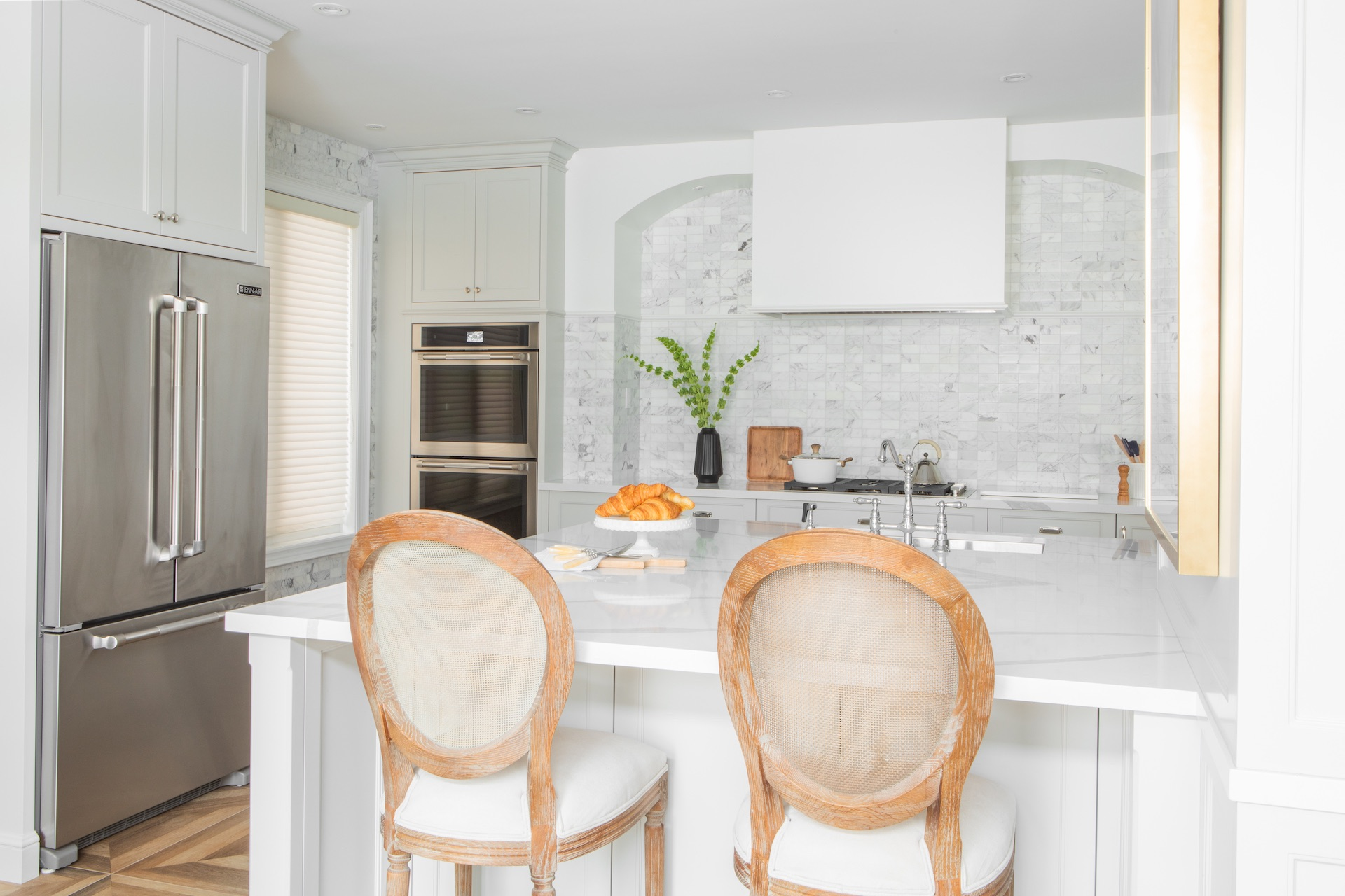 white kitchen with wood bar stools