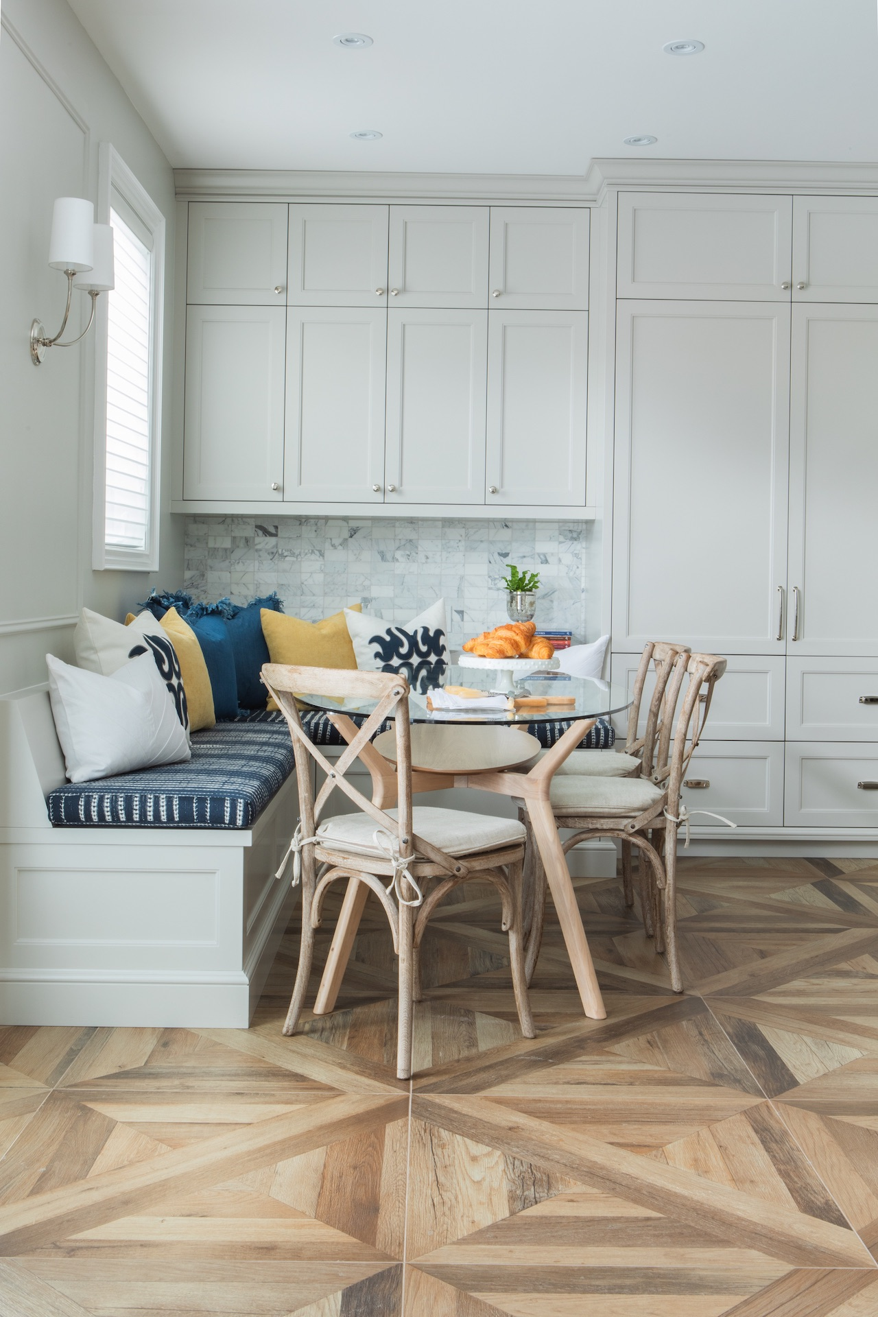 glass and wood kitchen table with wood chairs