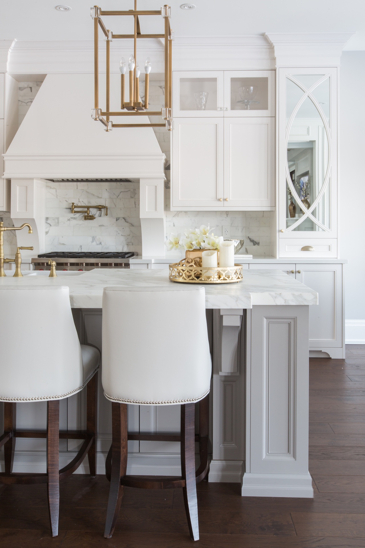 white kitchen with bar stools