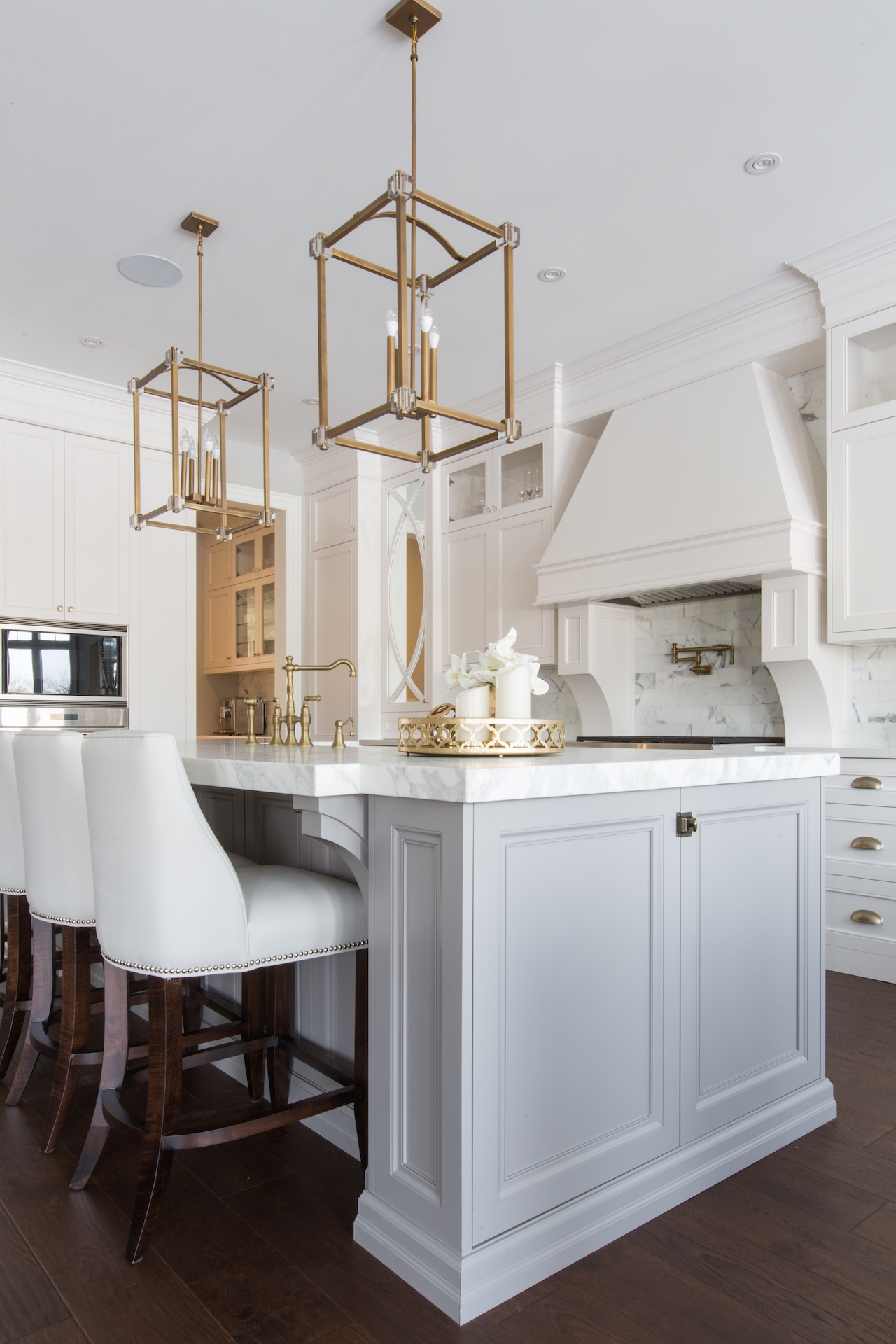 white island with chairs and gold hardware