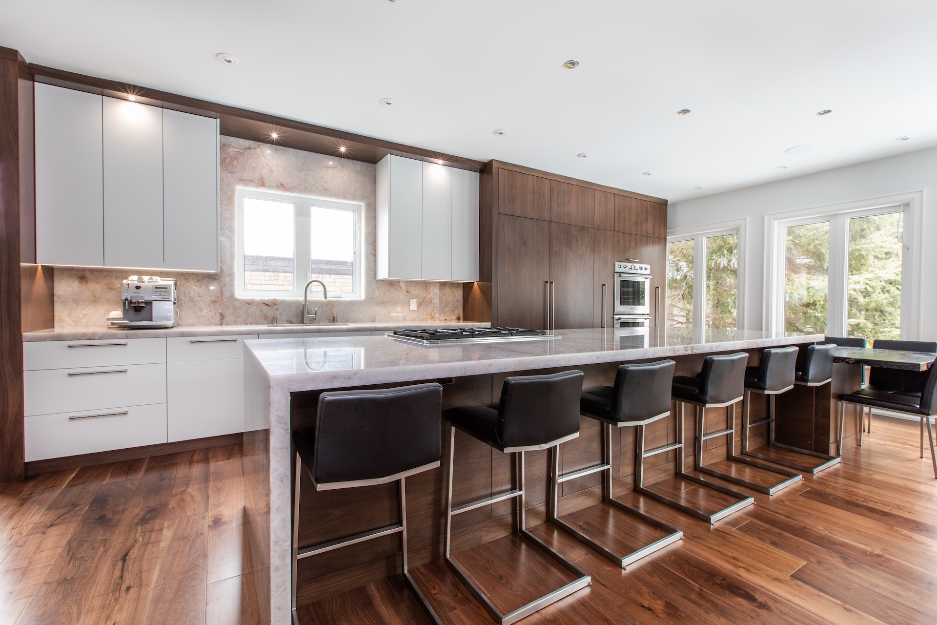Kitchen with black bar stools