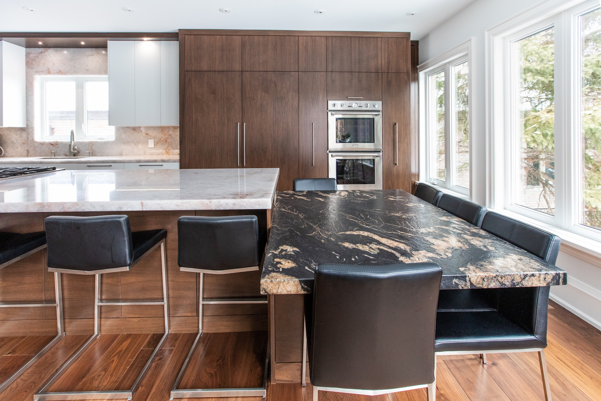 Wood kitchen with marble and black bar stools