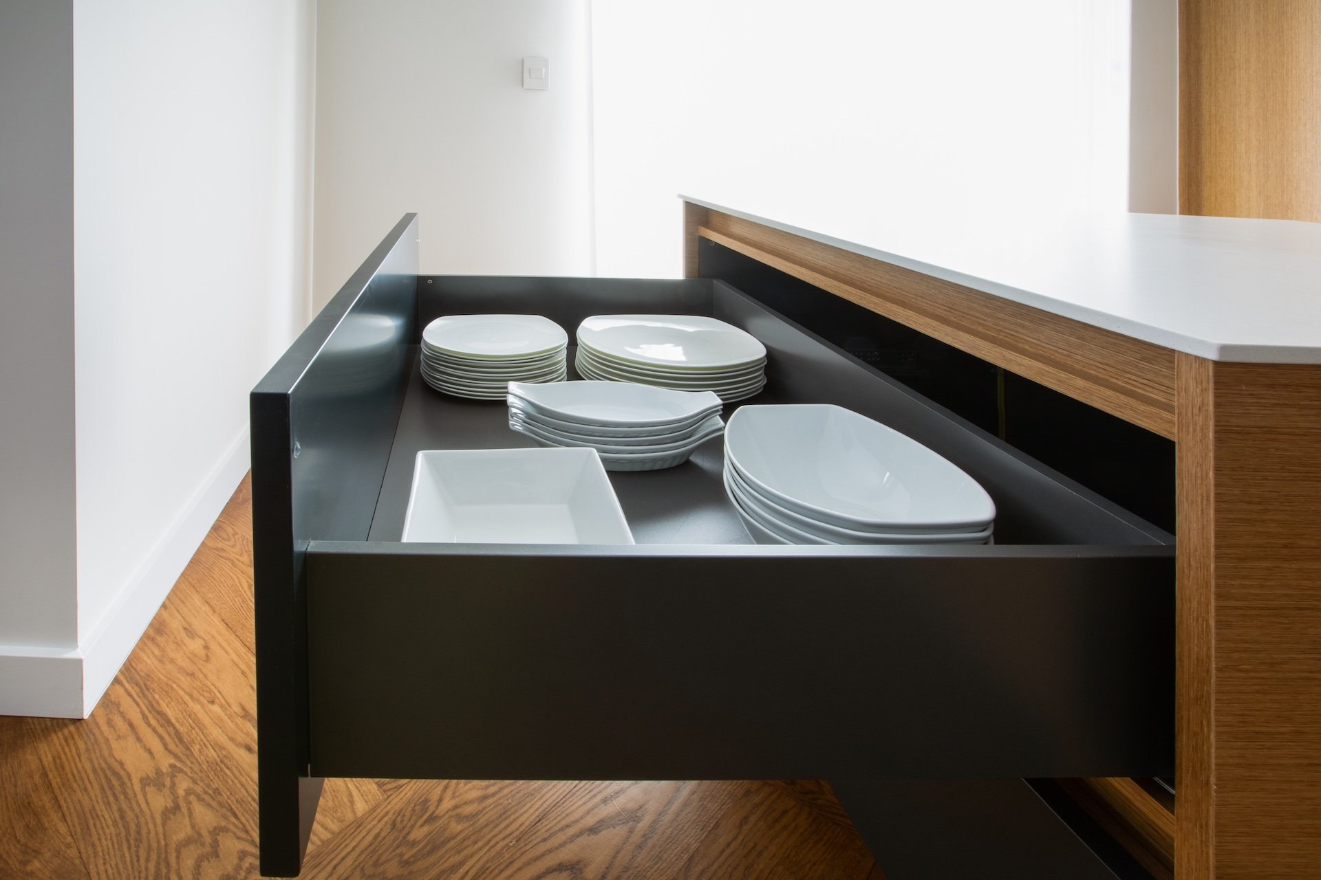 black drawer open with dishes