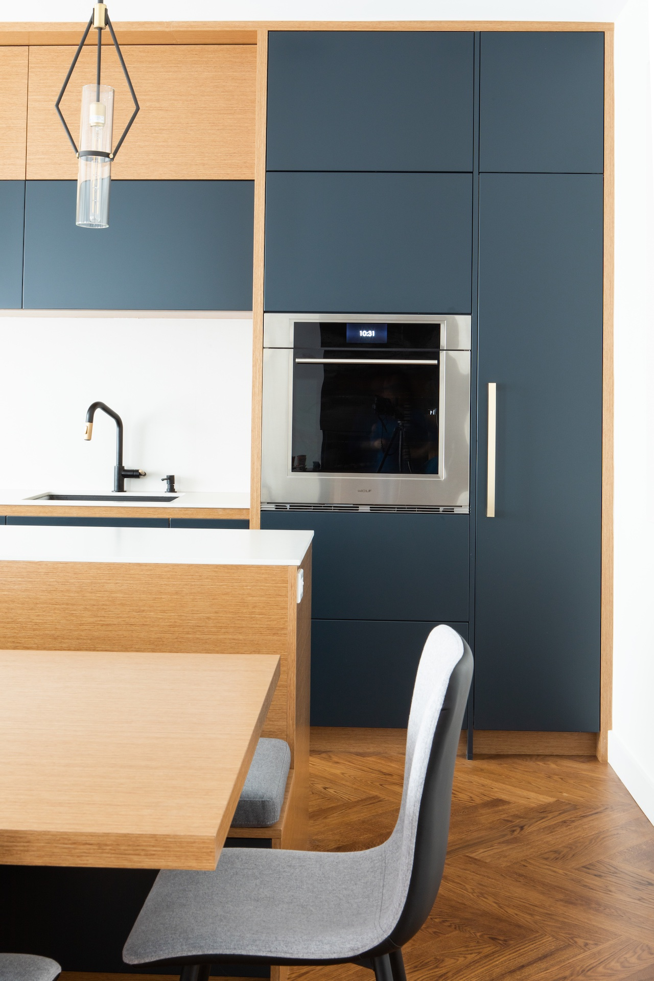 Natural wood and blue contemporary kitchen with oven