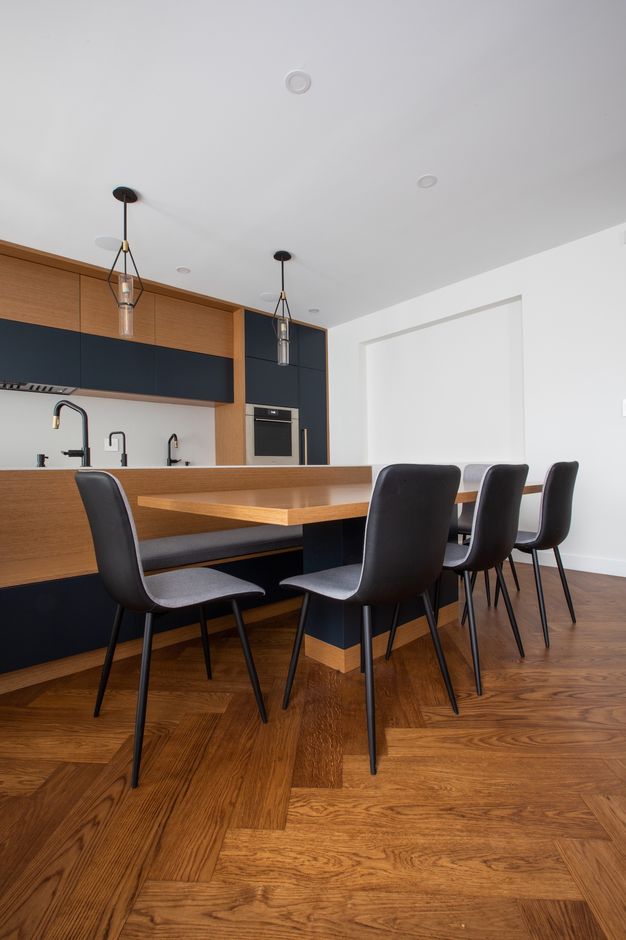 Natural wood table with black chairs