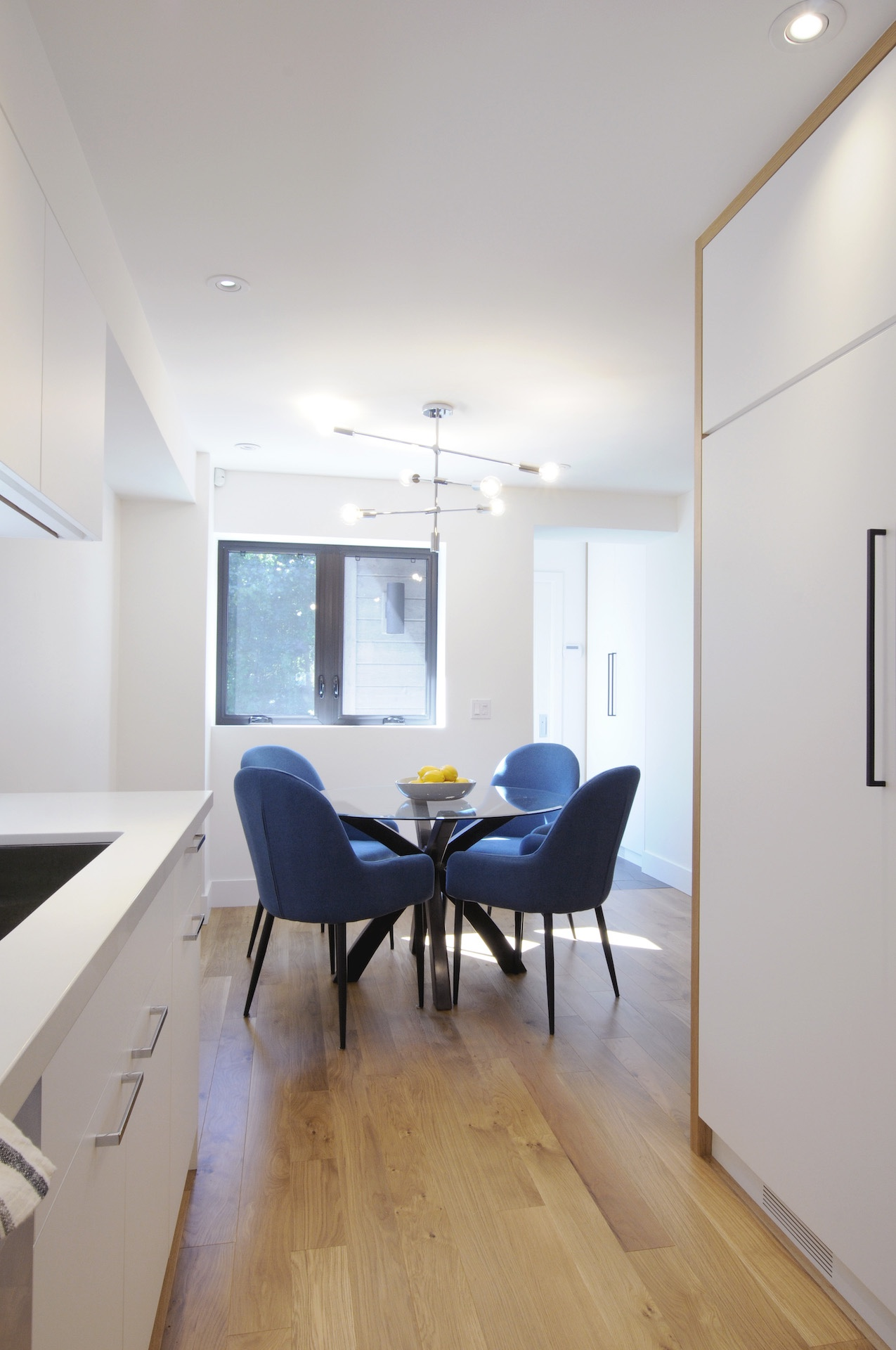 round dining table with blue chairs