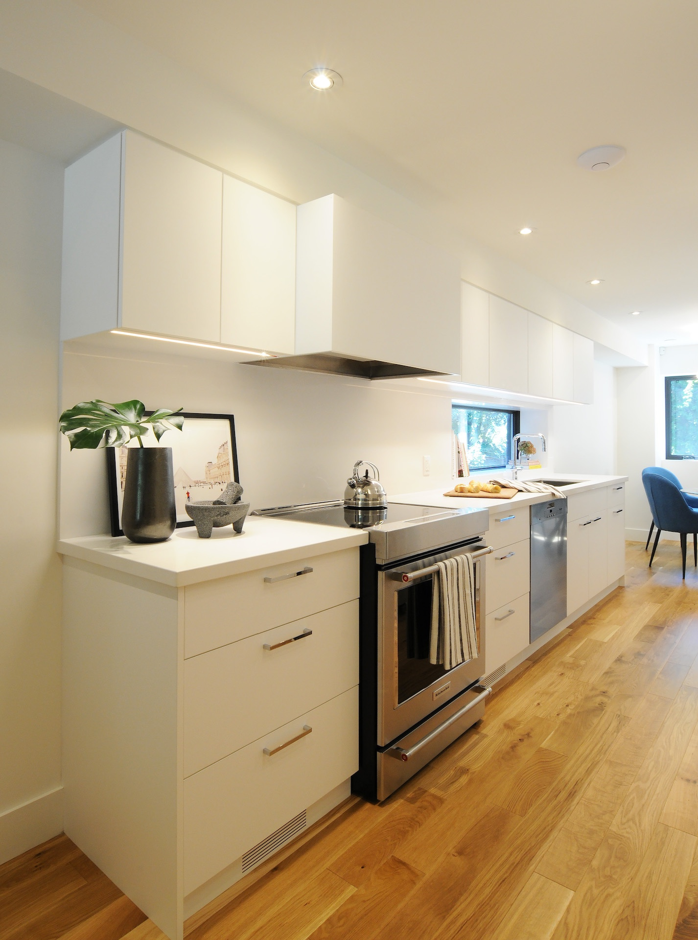 White kitchen drawers with oven