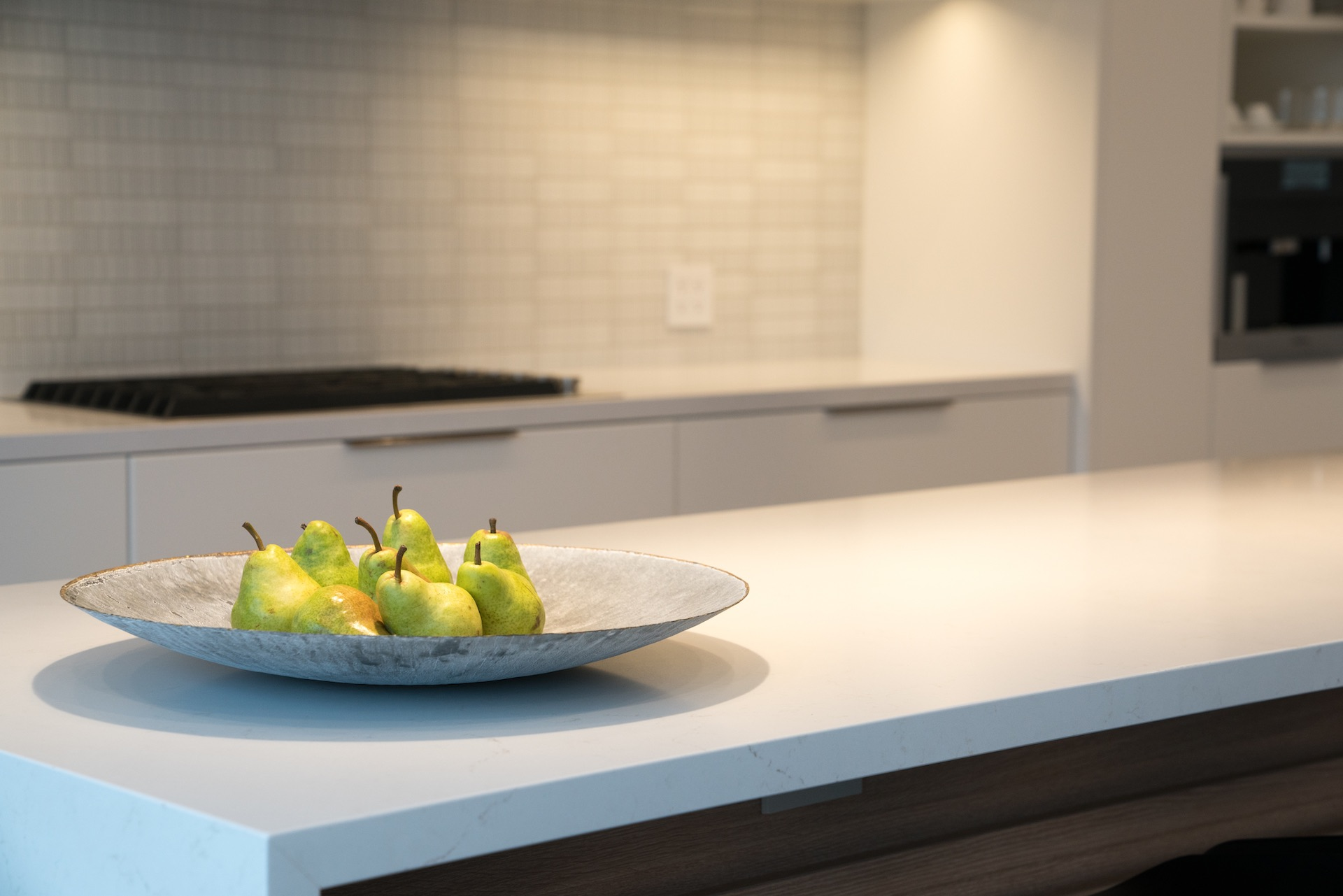 white counter with pears on plate
