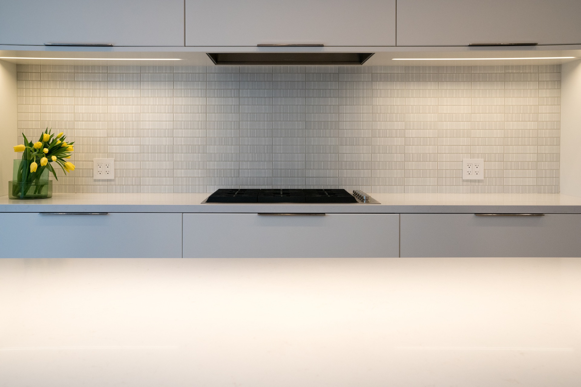 white counter with black grill stove