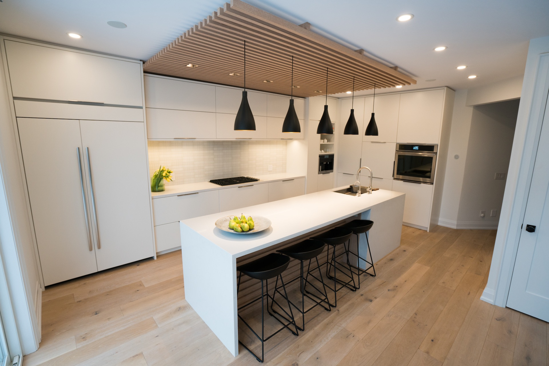 white contemporary kitchen with black bar stools