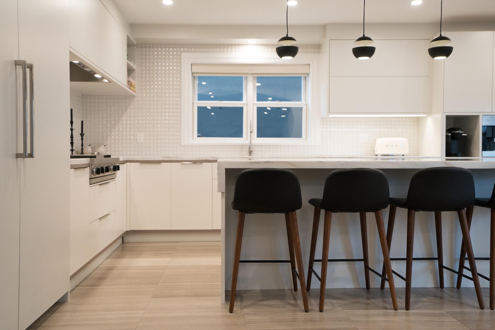 white kitchen with black stools