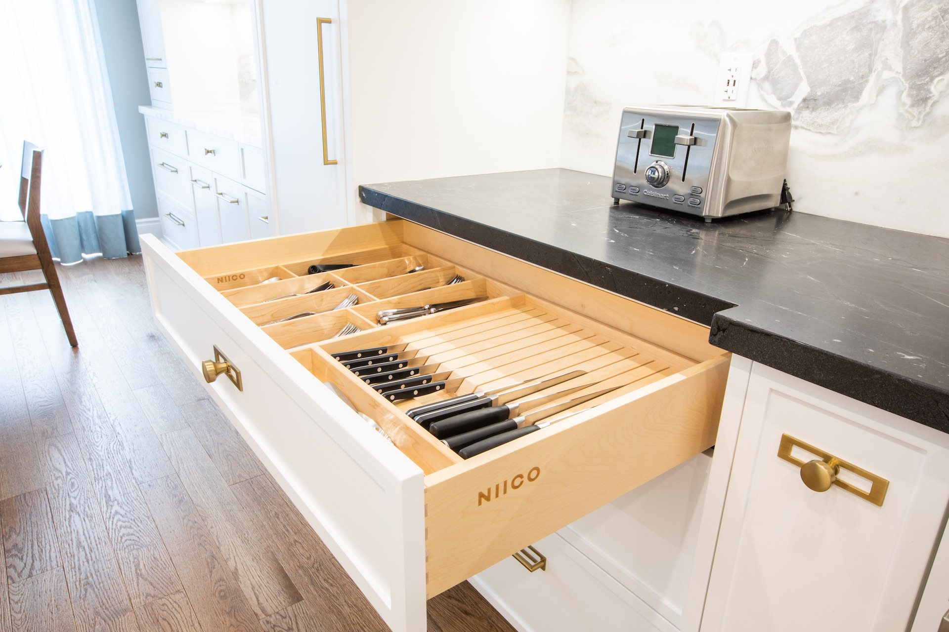 Wood kitchen drawer open with knives