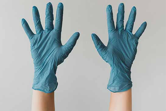 two hands wearing rubber gloves