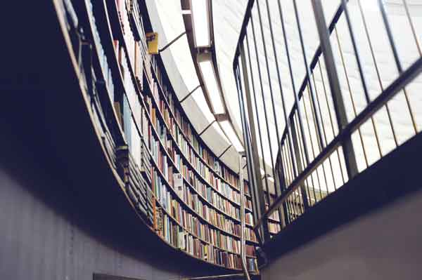 Image of books in a university library