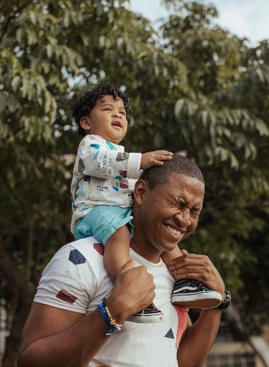 man giving child piggy back ride
