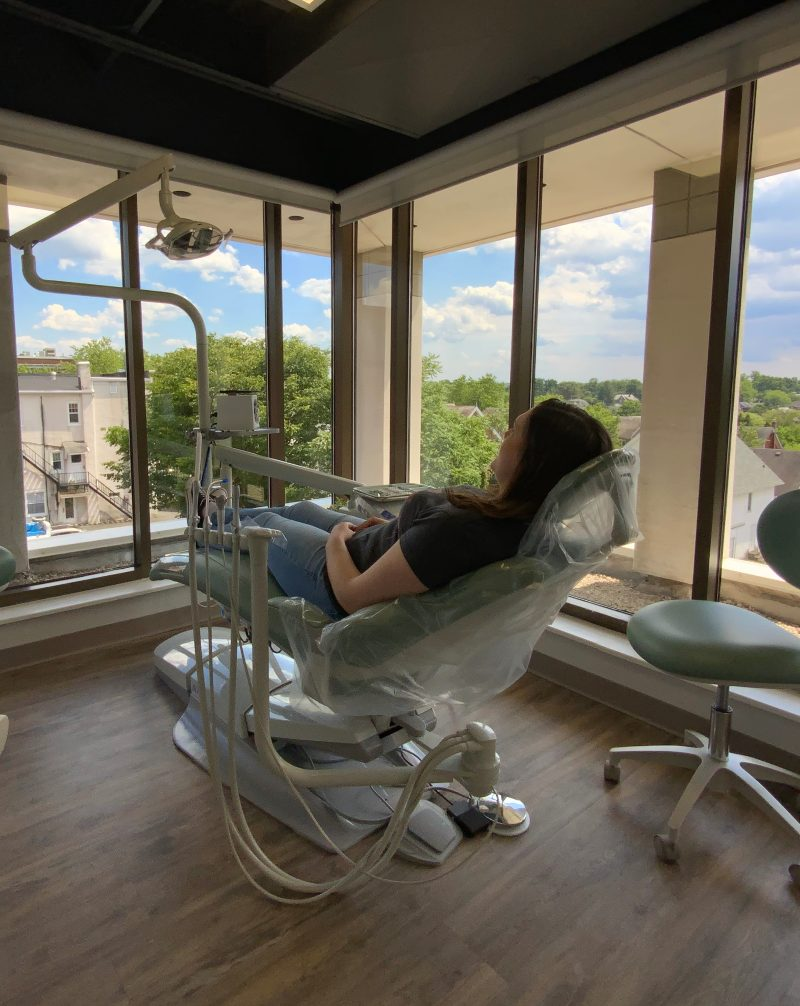 person in chair in dental office