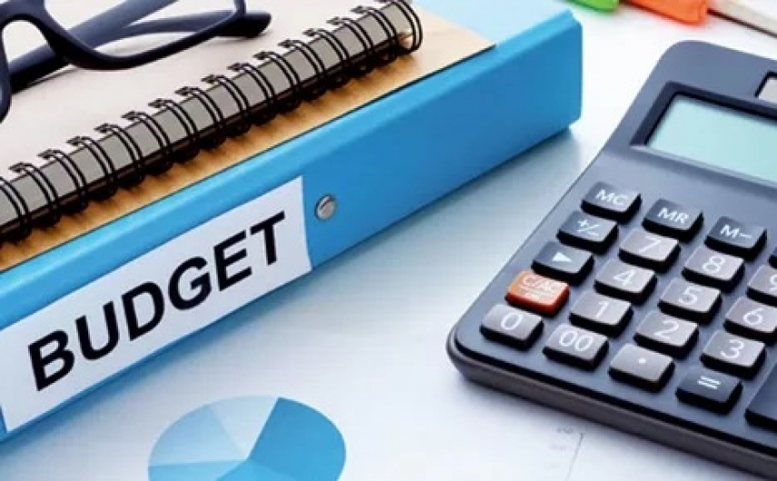 items on desk to plan your building budget