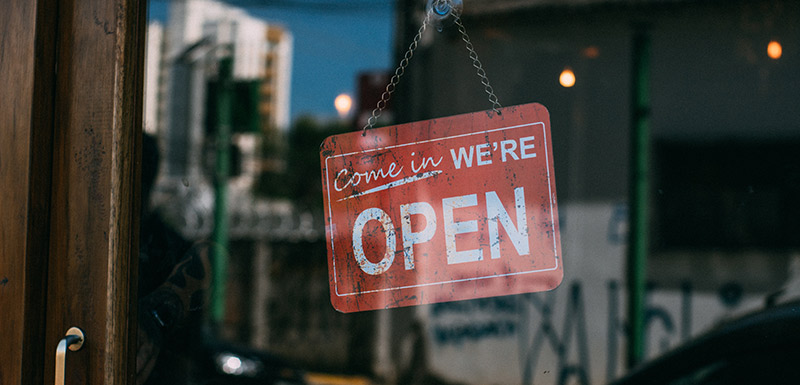 open sign in a window of a business