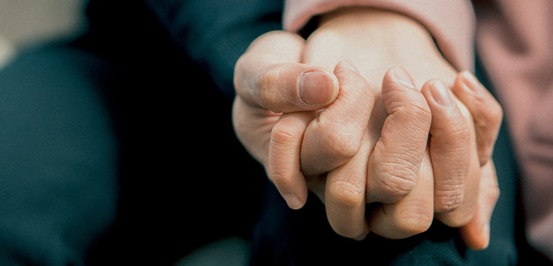 couple hands being held together