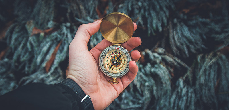 hand holding a compass to show directions for trusts