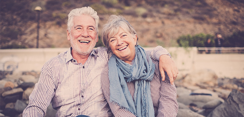 happy elderly couple who have a revocable living trust