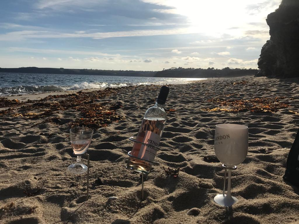 Wine on the beach with glasses, glass and wine holder