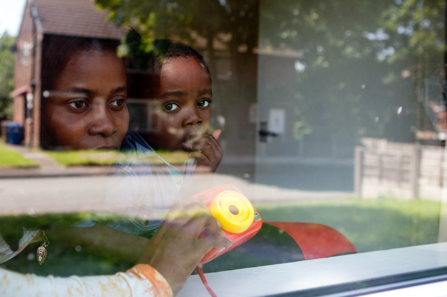 A mother and child looking out of a window