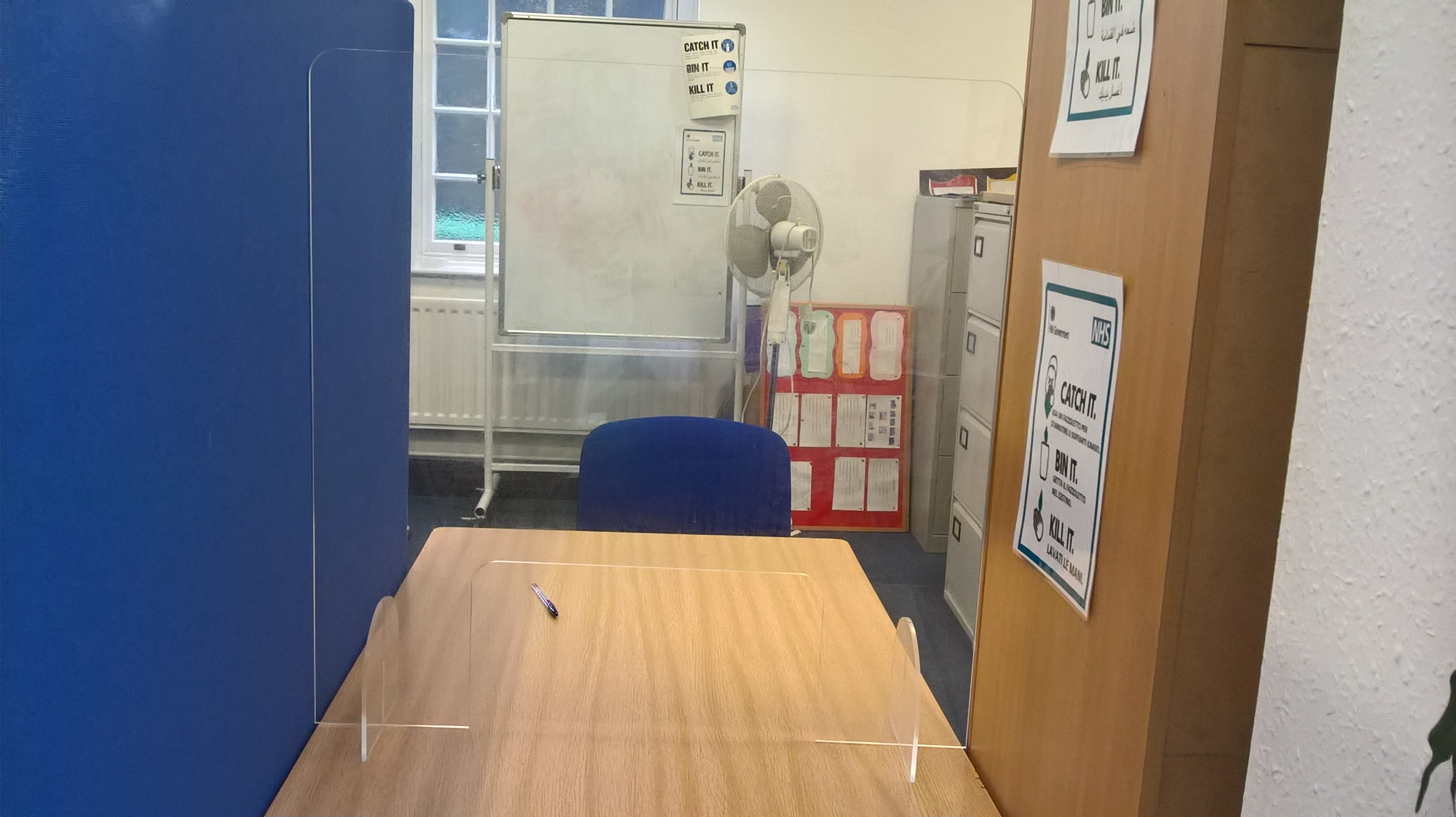 An image of desks at brushstrokes charity centre with PPE
