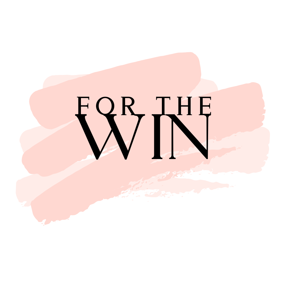 """The """"For The Win"""" logo using a pastel pink paint brush illustration with a text overlay."""