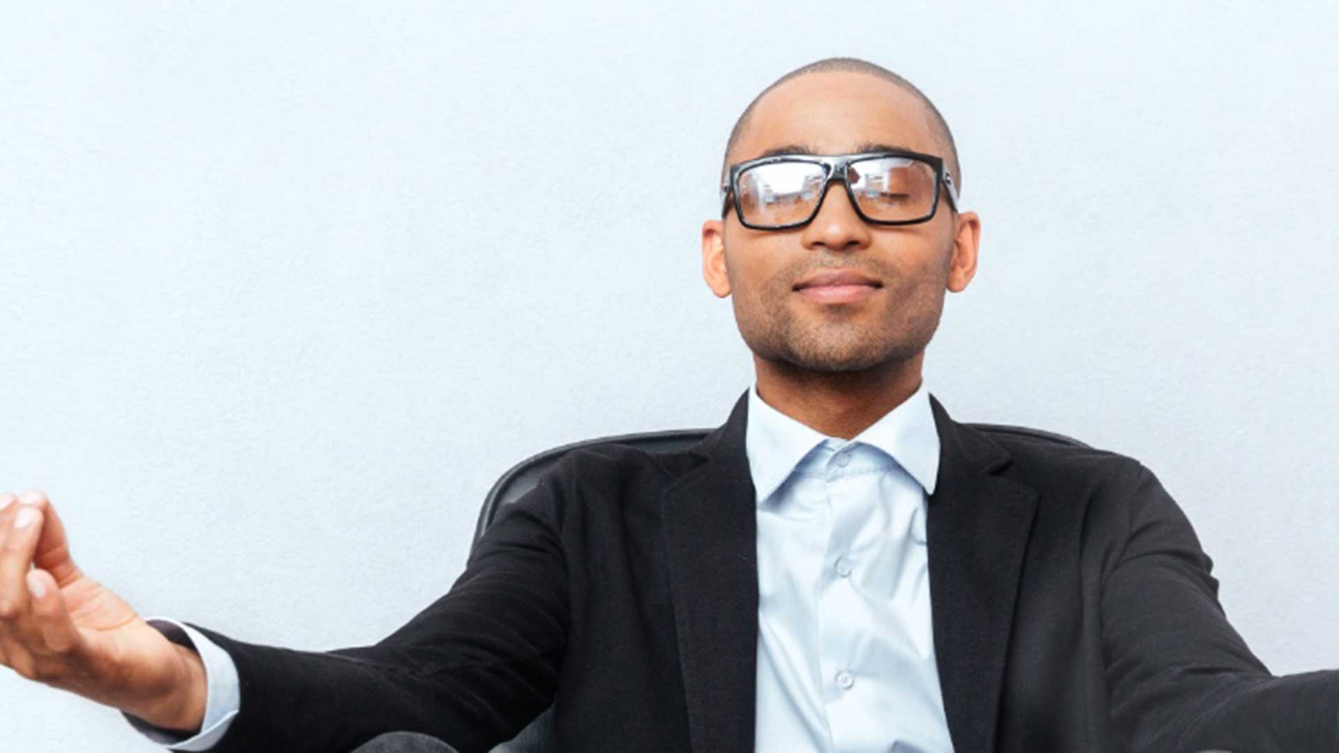 Businessman practising meditation