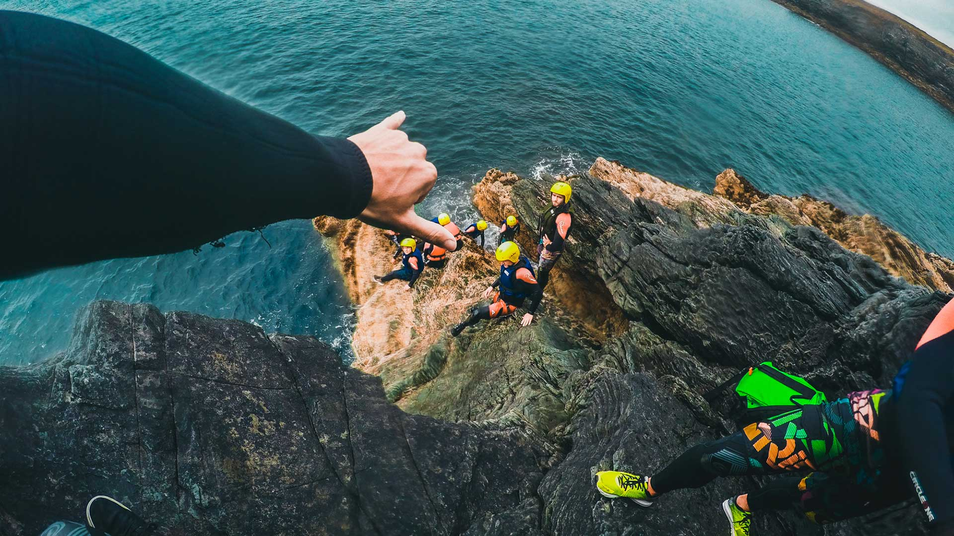 rock climbing by the sea with teenagers and instructors
