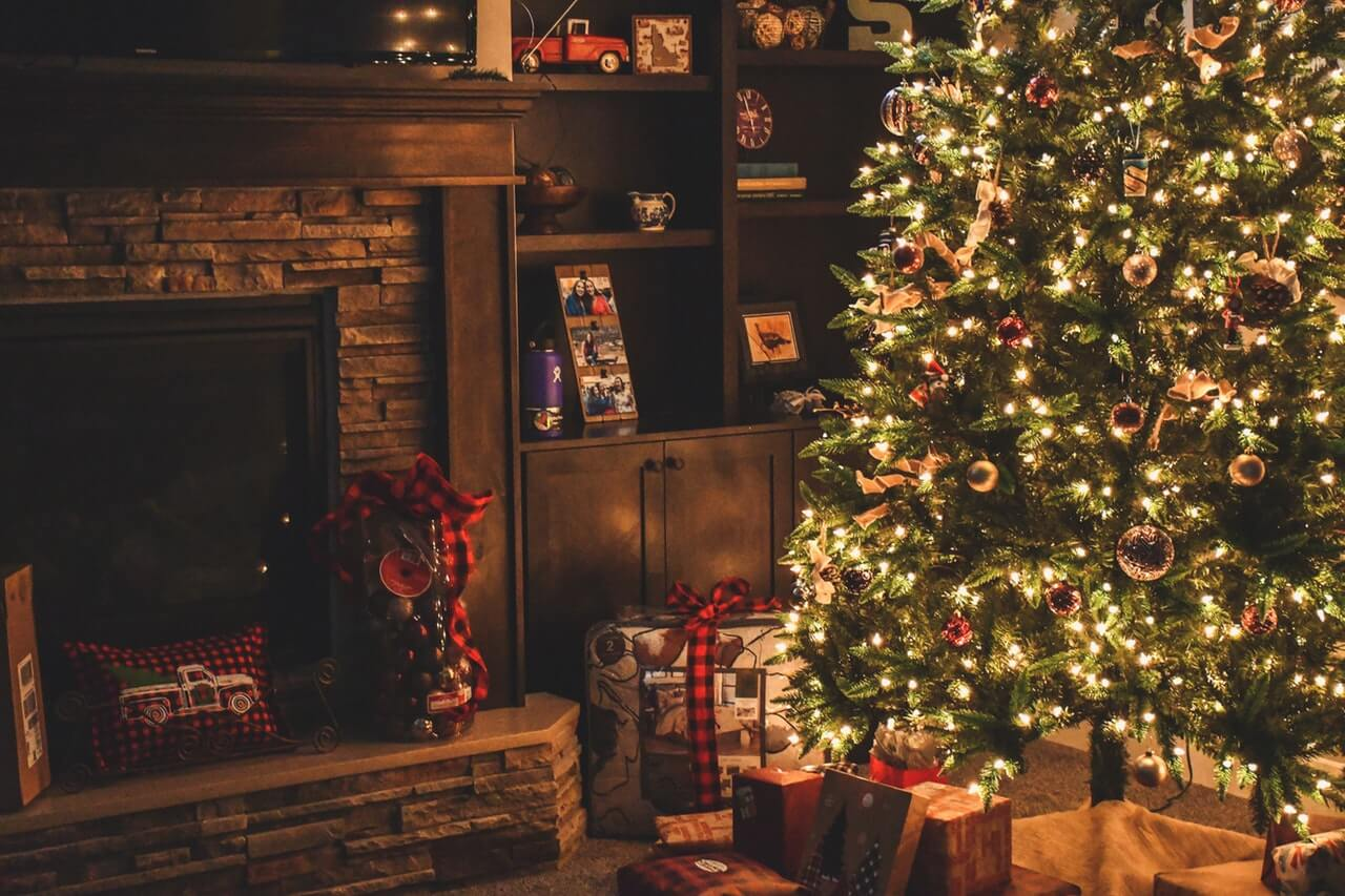 A decorated Christmas tree in a cozy living room