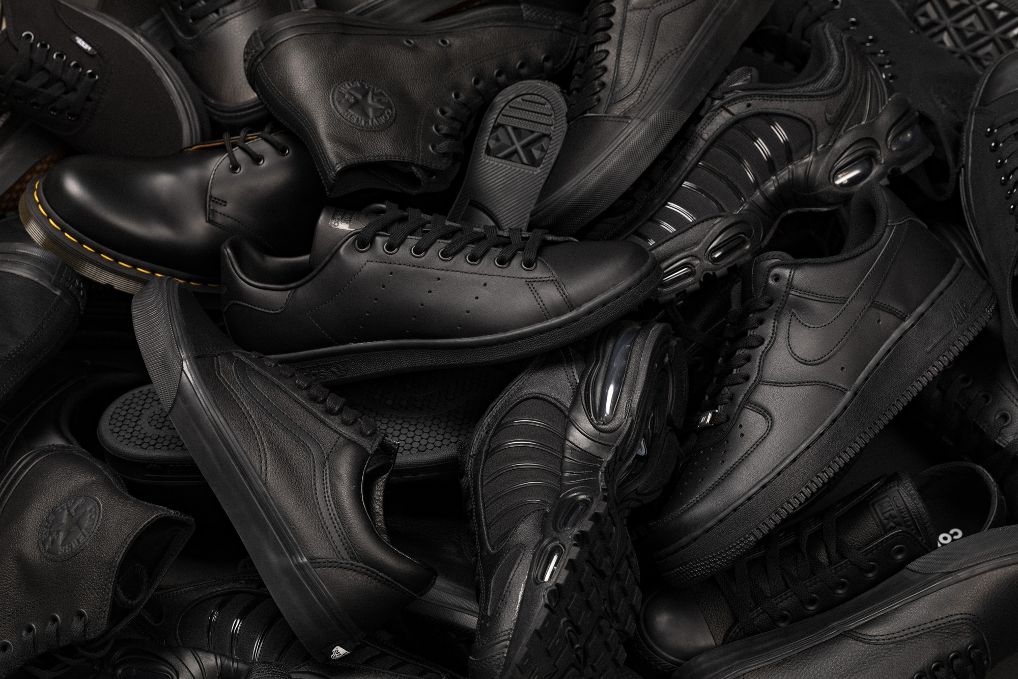 Assortment of footwear in triple black colourway