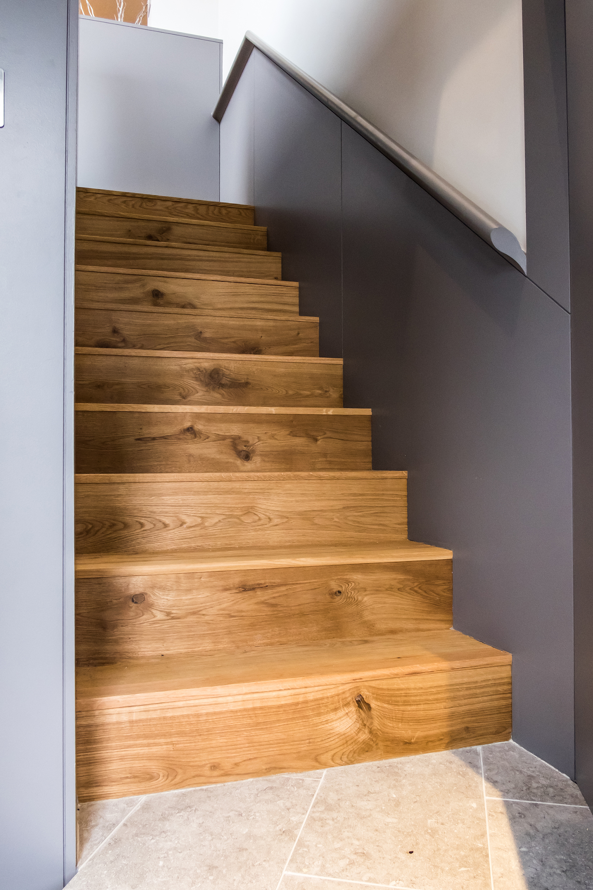 Looking up a set of wooden stairs