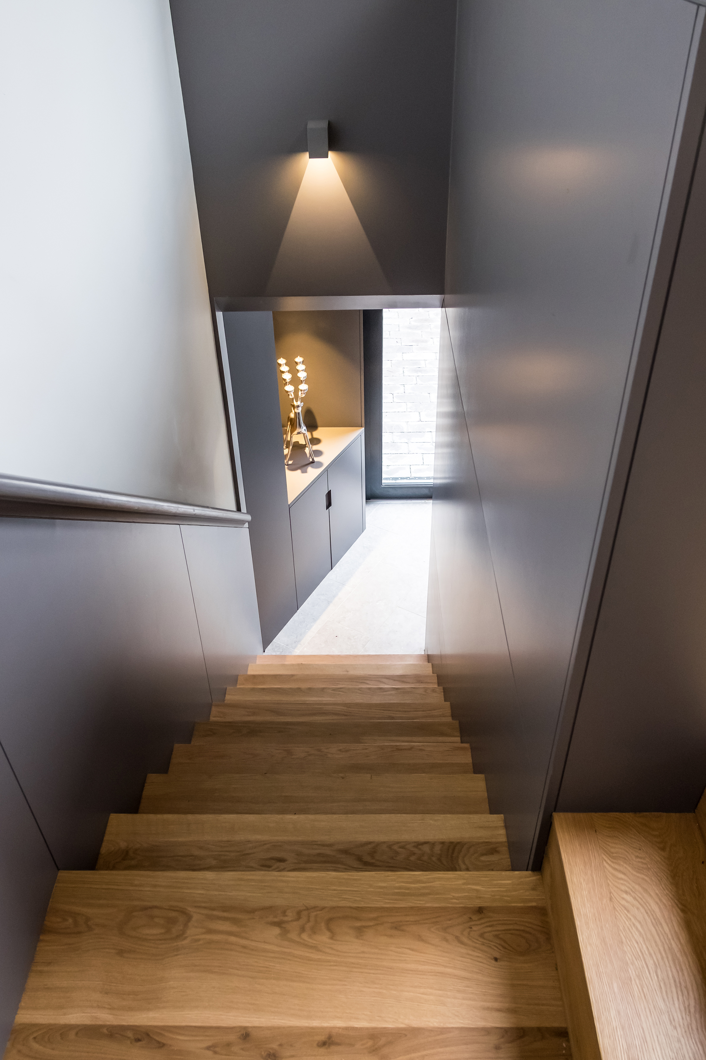 Looking straight down a set of wooden stairs