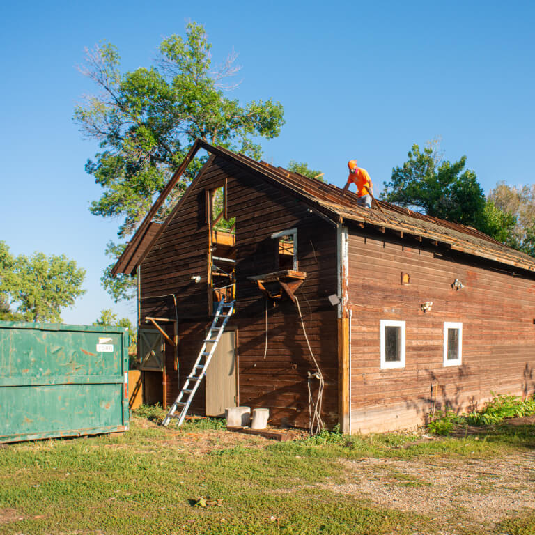 front view of a residential-house-building-demolition-deconstruction-boulder