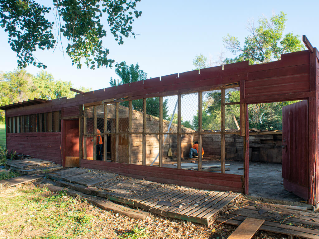 side view of a residential-house-building-demolition-deconstruction-boulder