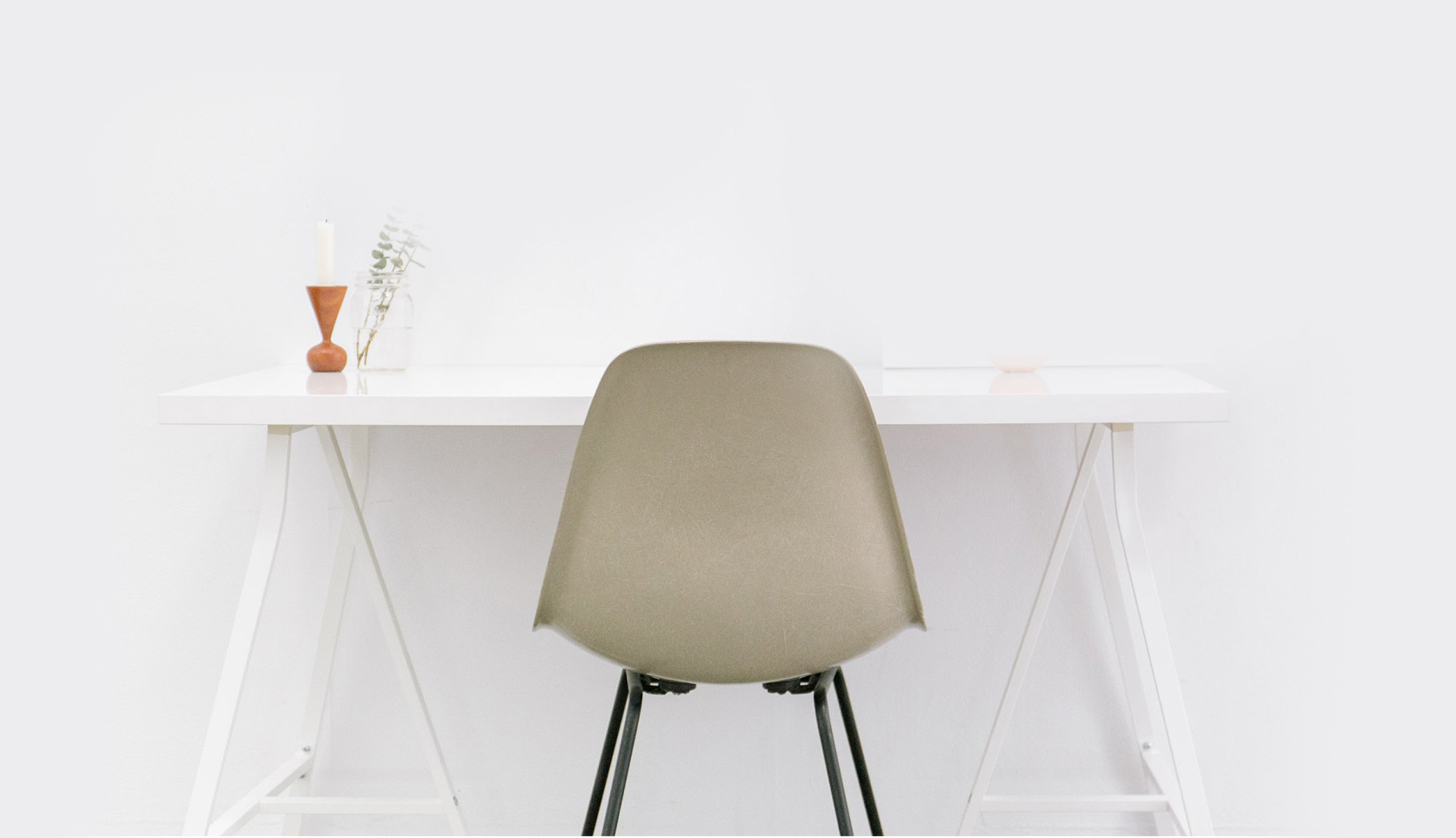 Footer image of a desk with RentWinnipeg listings above