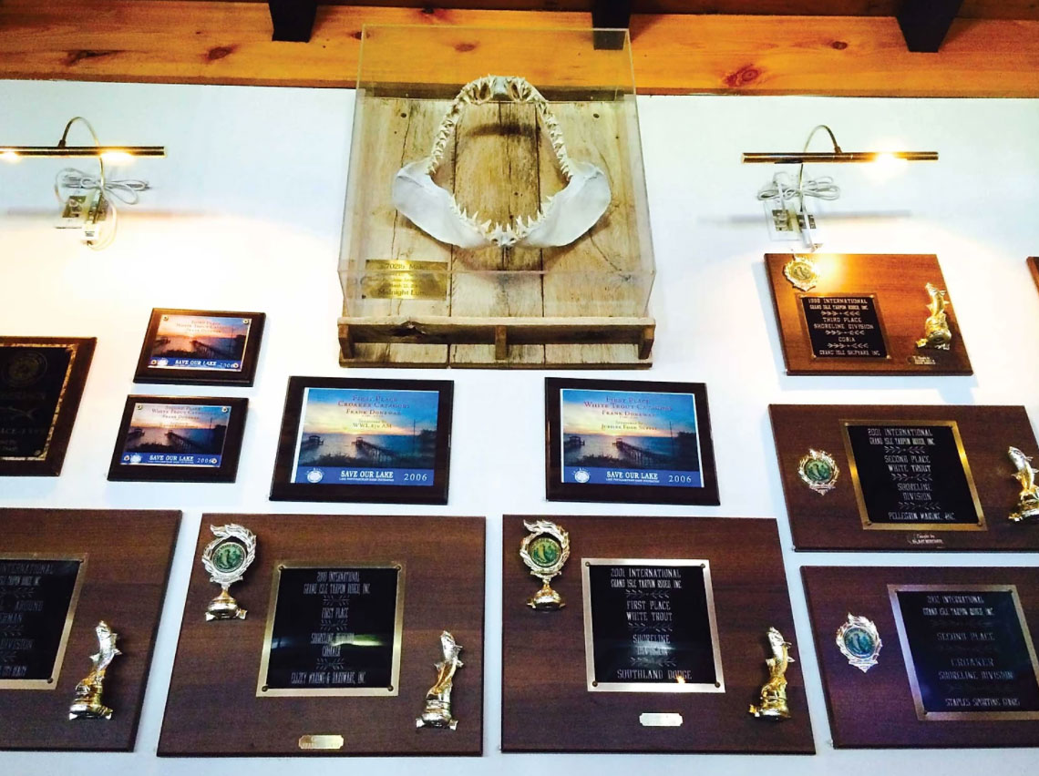 awards wall from winning catches and a set of mako shark teeth