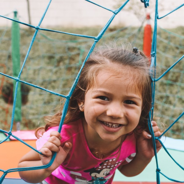 a girl smiling at a playground