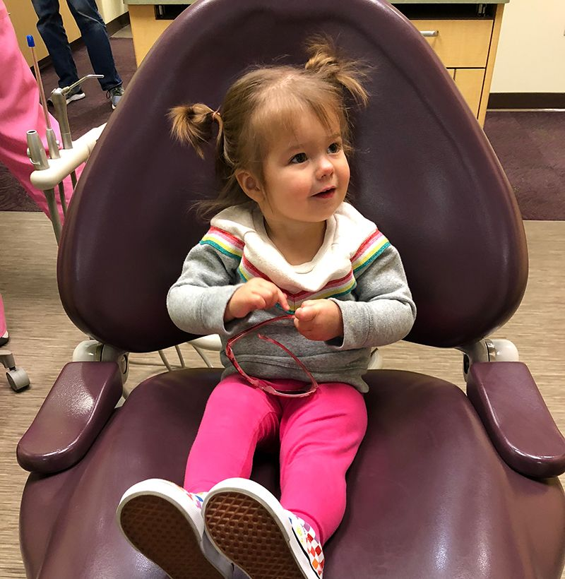 Dr. Nick's daughter sitting in dental chair