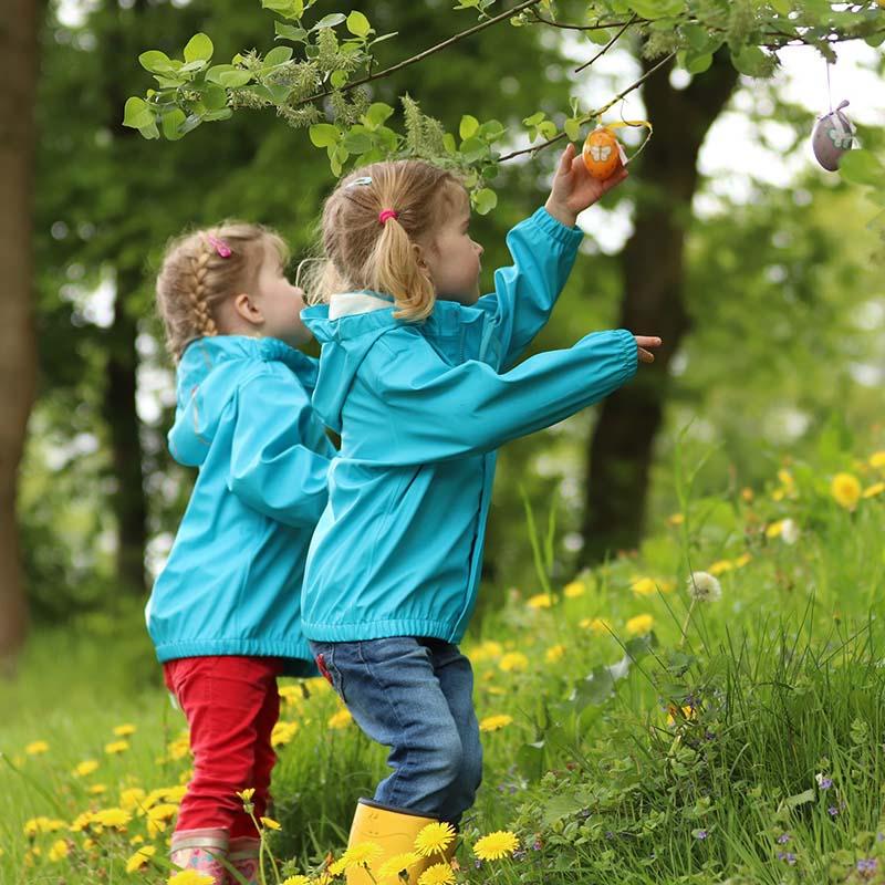 two girls picking easter eggs