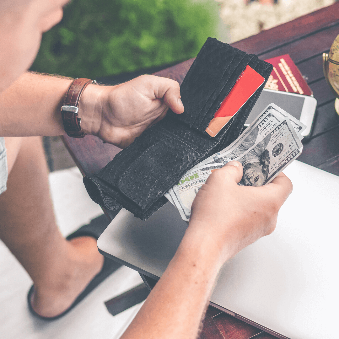 Image of person looking at money in wallet
