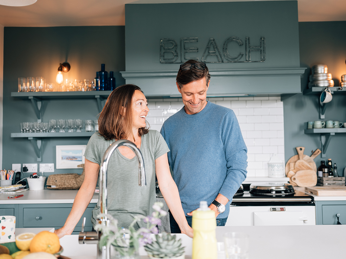man and wife in the kitchen