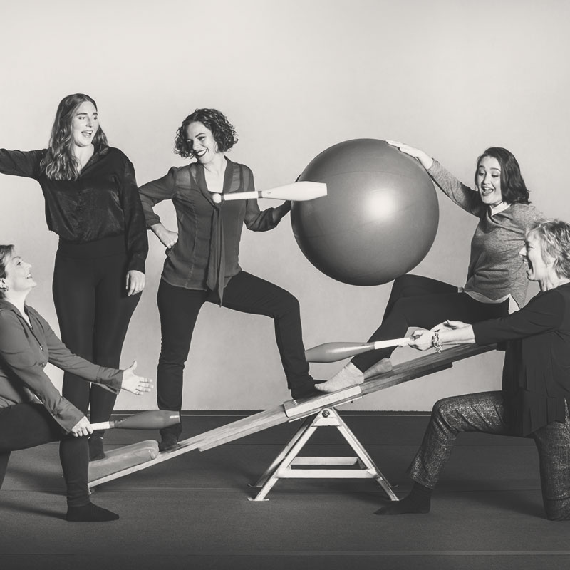bizable media team of woman on circus equipment for the redesign of bizable media's website on the webflow platform.