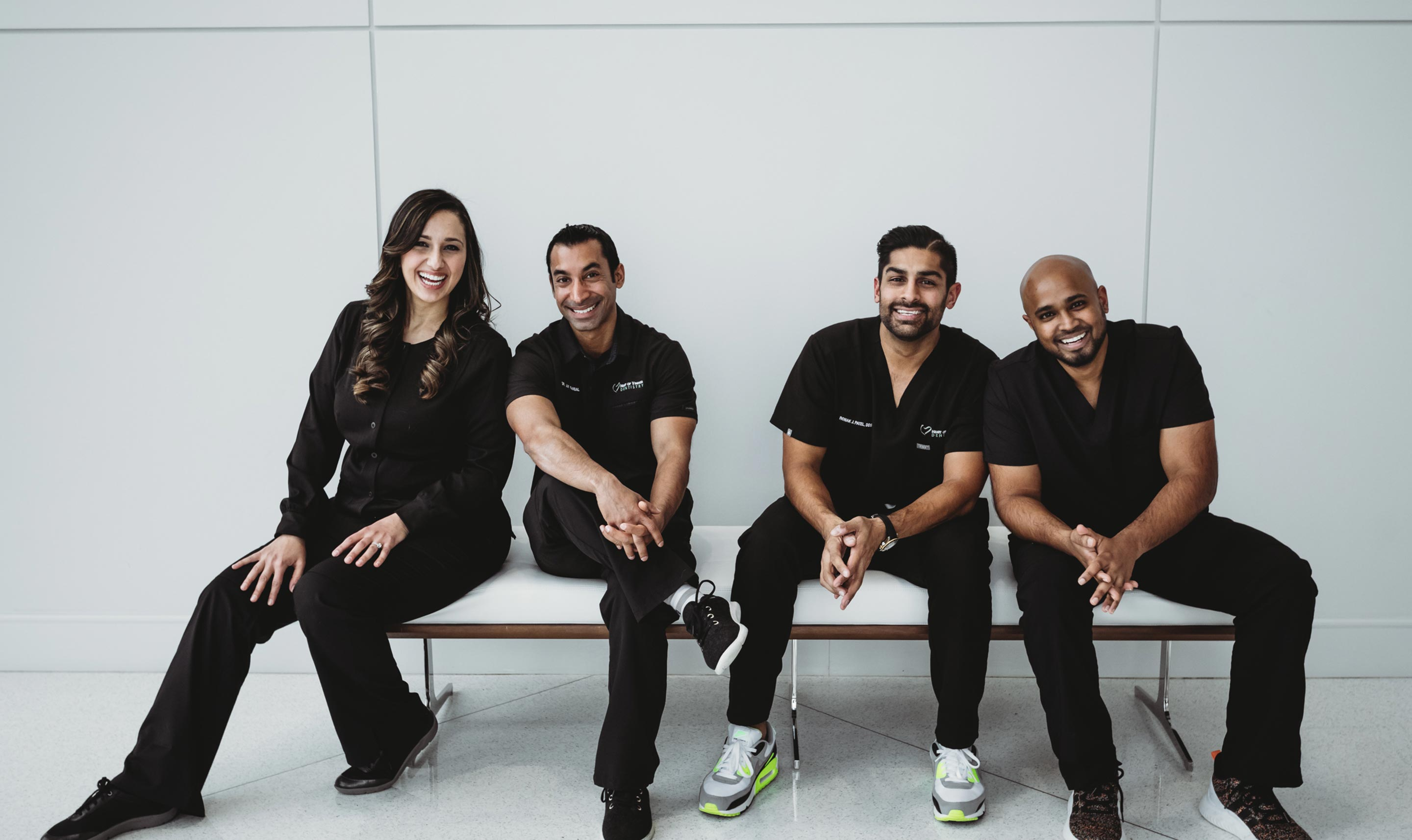 Photo Dr. Samira Jafari, Dr. Roonak Patel, Dr. Jay Kansal, and Dr. Mark Persaud sitting on a bench