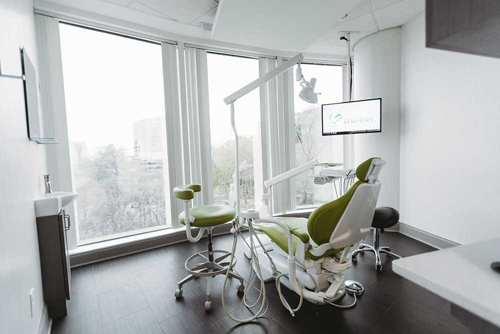 Photo of a bright dental operatory and chair