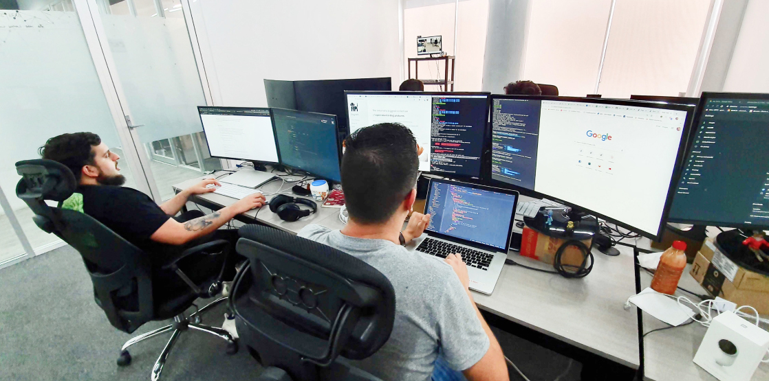 Two men working on computers