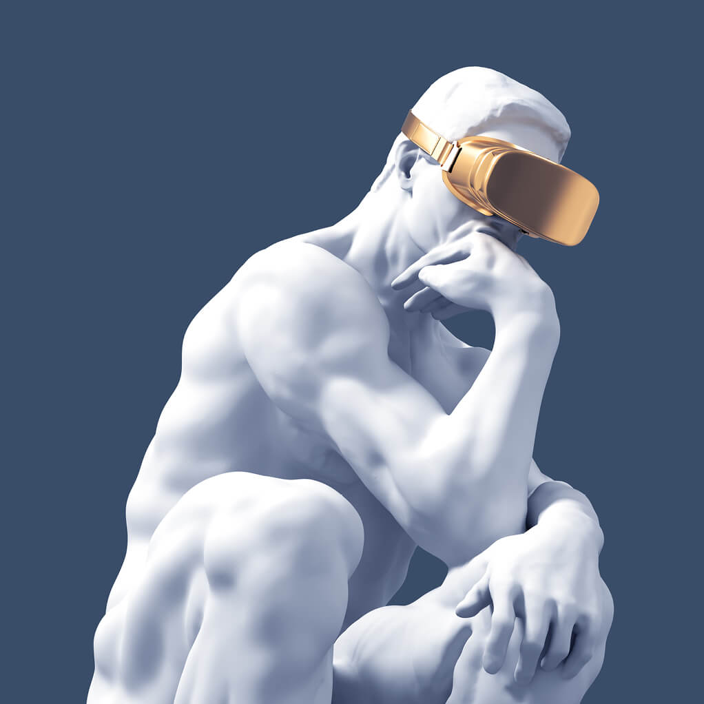 photo of white marble statue with golden VR glasses