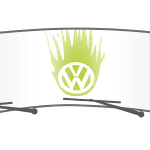 Green VW logo on a car's windshield